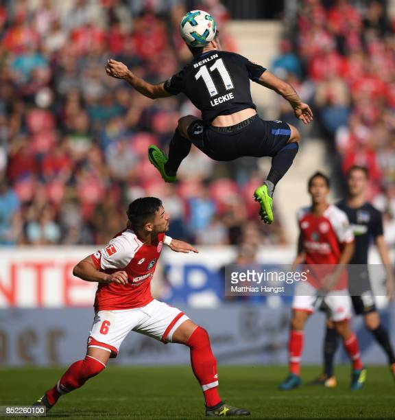 Mathew Leckie of Berlin jumps over Danny Latza of Mainz during the Bundesliga match between 1 FSV Mainz 05 and Hertha BSC at Opel Arena on September...