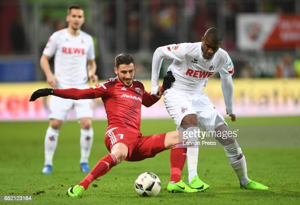 Mathew Leckie of FC Ingolstadt challenges Anthony Modeste of 1 FC Koeln during the Bundesliga match between FC Ingolstadt 04 and 1 FC Koeln at Audi...