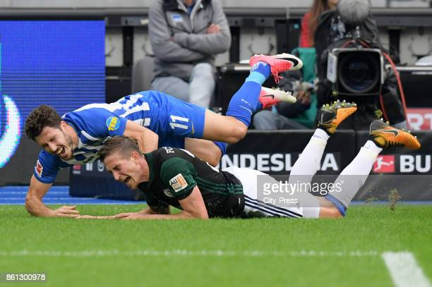 Mathew Leckie of Hertha BSC and Bastian Oczipka of FC Schalke 04 during the game between Hertha BSC and Schalke 04 on october 14 2017 in Berlin...