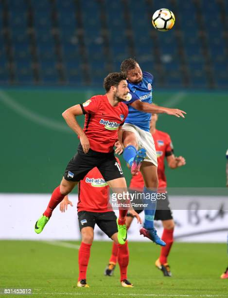 Mathew Leckie of Hertha BSC and Marcel Ziemer of FC Hansa Rostock during the game between FC Hansa Rostock and Hertha BSC on August 14 2017 in...