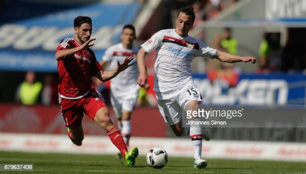 Mathew Leckie of Ingolstadt and Julian Baumgartlinger of Leverkusen head for the ball during the Bundesliga match between FC Ingolstadt 04 and Bayer...