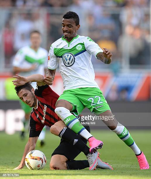 Mathew Leckie of Ingolstadt and Luiz Gustavo of Wolfsburg compete for the ball during the Bundesliga match between FC Ingolstadt and VfL Wolfsburg at...