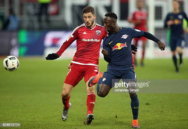 Mathew Leckie of Ingolstadt fights for the ball with Naby Deco Keita of Leipzig during the Bundesliga match between FC Ingolstadt 04 and RB Leipzig...