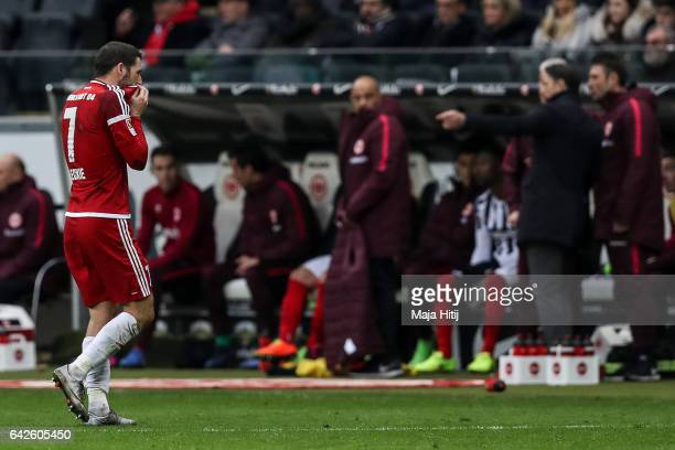 Mathew Leckie of Ingolstadt walks off the pitch after receiving a red card from referee during the Bundesliga match between Eintracht Frankfurt and...