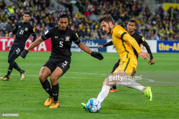 Mathew Leckie of the Australian National Football Team and Adisorn Promrak of the Thailand National Football Team contest the ball during the FIFA...