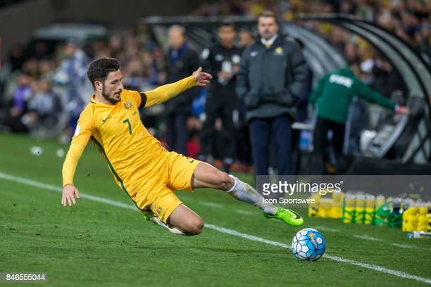 Mathew Leckie of the Australian National Football Team attempts to keep the ball in play during the FIFA World Cup Qualifier Match Between the...