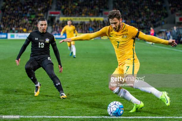 Mathew Leckie of the Australian National Football Team keeps the ball in play in front of Tristan Do of the Thailand National Football Team during...