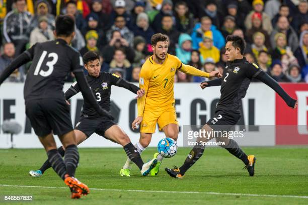 Mathew Leckie of the Australian National Football Team Peerapat Notchaiya of the Thailand National Football Team and Theerathon Bunmathan of the...