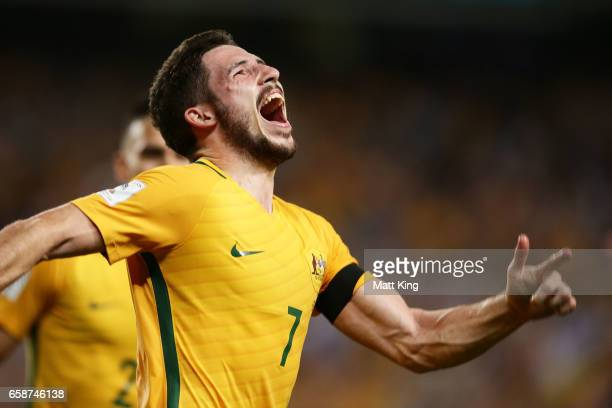Mathew Leckie of the Socceroos celebrates scoring the second goal during the 2018 FIFA World Cup Qualifier match between the Australian Socceroos and...