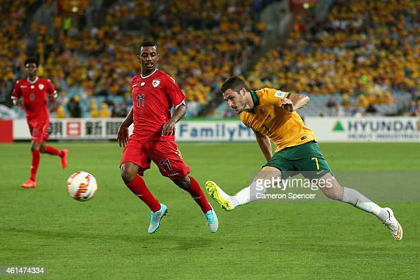 Mathew Leckie of the Socceroos passes during the 2015 Asian Cup match between Oman and Australia at ANZ Stadium on January 13 2015 in Sydney Australia