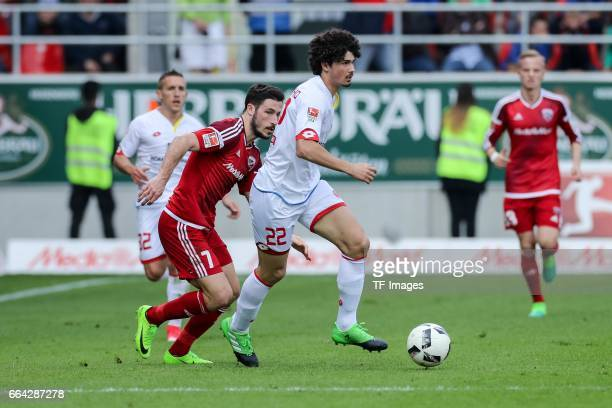 Mathew Leckieof Ingolstadt and Andre Ramalho of Mainz battle for the ball during the Bundesliga match between FC Ingolstadt 04 and 1 FSV Mainz 05 at...