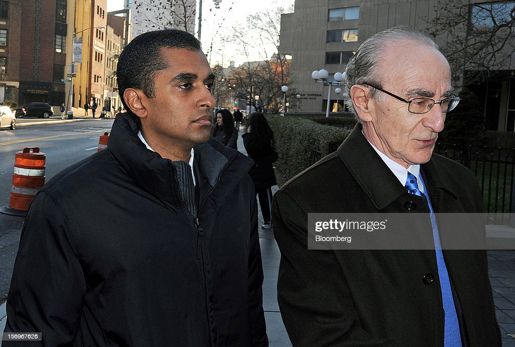 Mathew Martoma, a former portfolio manager at a unit of SAC Capital Advisors LP, left, enters federal court with defense lawyer Charles Stillman, right, in New York, U.S., on Monday, Nov. 26, 2012. Martoma, 38, used illegal tips to help SAC make $276 million on shares of pharmaceutical companies Elan Corp. and Wyeth LLC, according to the Justice Department and the Securities and Exchange Commission. Photographer: Peter Foley/Bloomberg via Getty Images