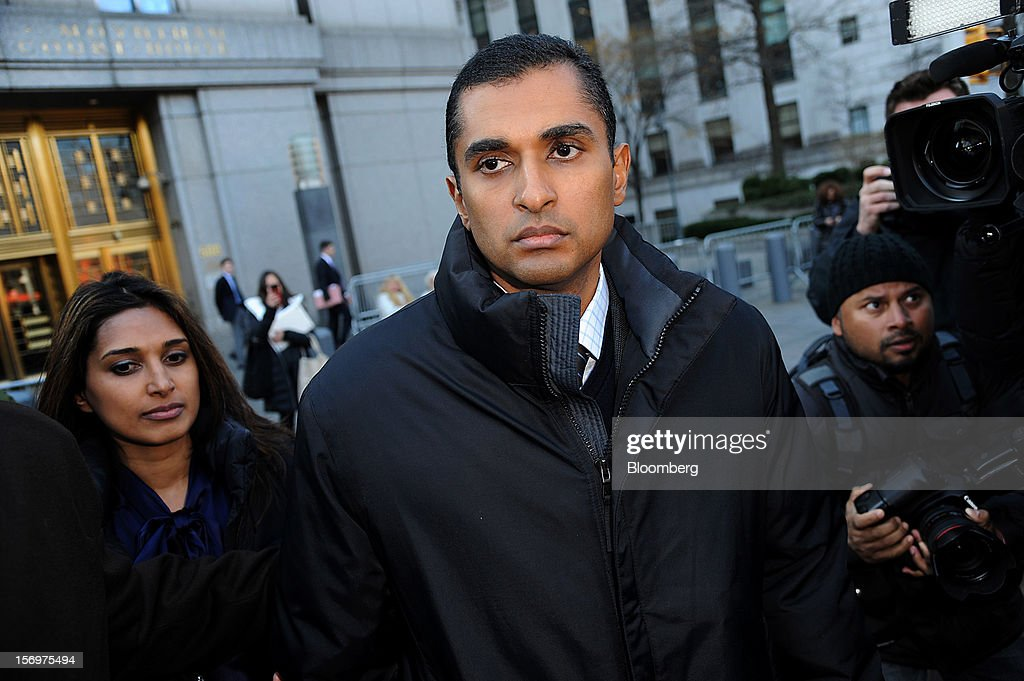 Mathew Martoma, a former portfolio manager at a unit of SAC Capital Advisors LP, center, exits federal court in New York, U.S., on Monday, Nov. 26, 2012. Martoma's arrest came six years after he set upon a path that has led him to a choice: one between a trial that may land him in prison for decades, or a deal to implicate others, possibly including SAC founder Steven A. Cohen. Photographer: Peter Foley/Bloomberg via Getty Images