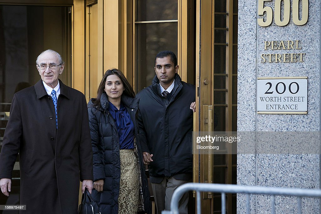 Mathew Martoma, a former portfolio manager at a unit of SAC Capital Advisors LP, right, exits federal court with defense lawyer Charles Stillman, left, in New York, U.S., on Monday, Nov. 26, 2012. Martoma's arrest came six years after he set upon a path that has led him to a choice: one between a trial that may land him in prison for decades, or a deal to implicate others, possibly including SAC founder Steven A. Cohen. Photographer: Scott Eells/Bloomberg via Getty Images