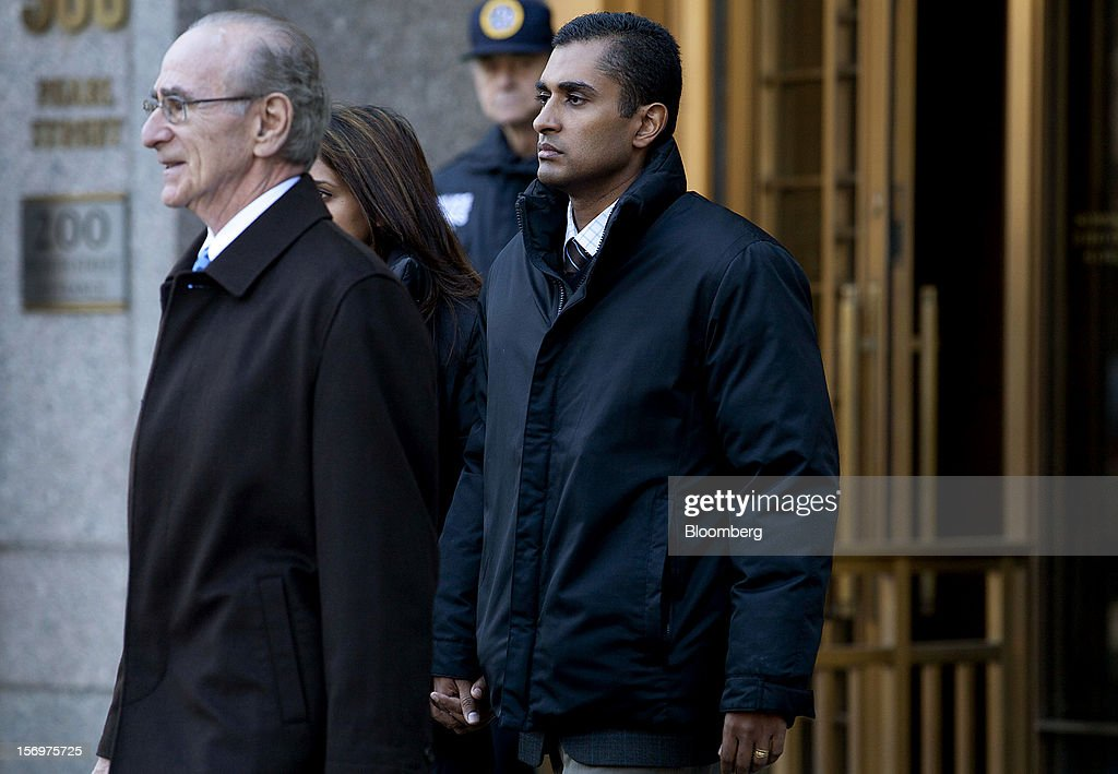 Mathew Martoma, a former portfolio manager at a unit of SAC Capital Advisors LP, center, exits federal court with defense lawyer Charles Stillman, left, in New York, U.S., on Monday, Nov. 26, 2012. Martoma's arrest came six years after he set upon a path that has led him to a choice: one between a trial that may land him in prison for decades, or a deal to implicate others, possibly including SAC founder Steven A. Cohen. Photographer: Jin Lee/Bloomberg via Getty Images