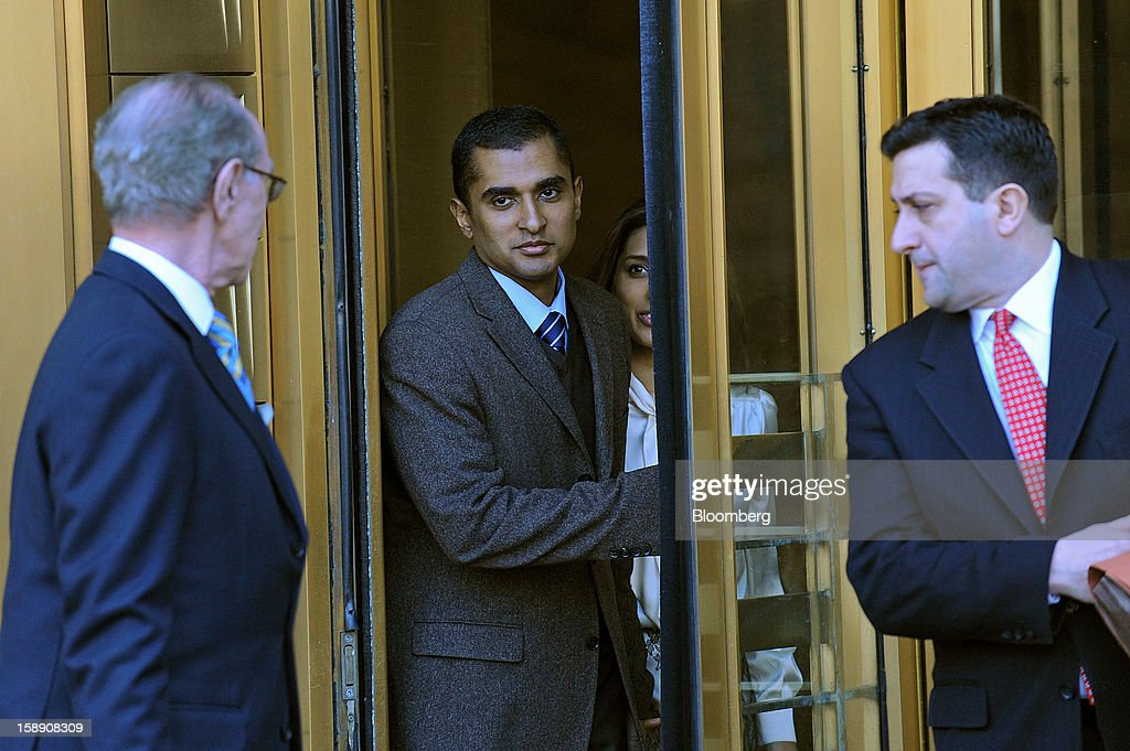 Mathew Martoma, a former portfolio manager at a unit of SAC Capital Advisors LP, second left, exits federal court with his attorney Charles Stillman, left, and wife Rosemary Martoma, second right, in New York, U.S., on Thursday, Jan. 3, 2013. Martoma, charged in what prosecutors called the biggest insider trading scheme in history, pleaded not guilty to criminal charges. Photographer: Peter Foley/Bloomberg via Getty Images