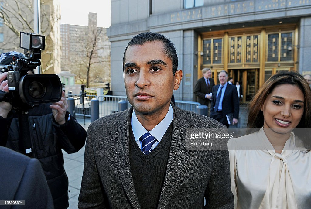 Mathew Martoma, a former portfolio manager at a unit of SAC Capital Advisors LP, left, exits federal court with his wife Rosemary Martoma in New York, U.S., on Thursday, Jan. 3, 2013. Martoma, charged in what prosecutors called the biggest insider trading scheme in history, pleaded not guilty to criminal charges. Photographer: Peter Foley/Bloomberg via Getty Images