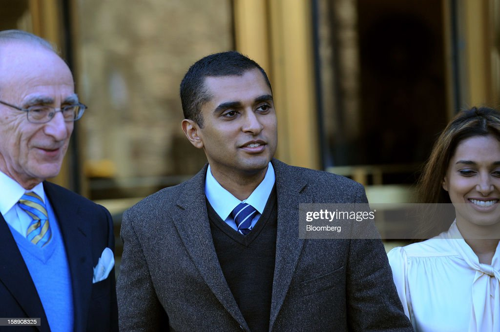 Mathew Martoma, a former portfolio manager at a unit of SAC Capital Advisors LP, center, exits federal court with his attorney Charles Stillman, left, and wife Rosemary Martoma in New York, U.S., on Thursday, Jan. 3, 2013. Martoma, charged in what prosecutors called the biggest insider trading scheme in history, pleaded not guilty to criminal charges. Photographer: Peter Foley/Bloomberg via Getty Images