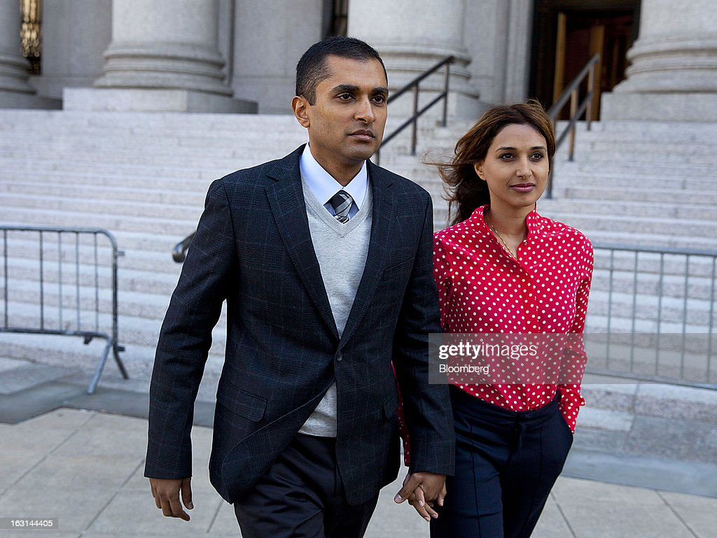 Mathew Martoma, a former portfolio manager at a unit of SAC Capital Advisors LP, left, exits federal court with his wife Rosemary Martoma in New York, U.S., on Tuesday, March 5, 2013. The judge presiding over the insider trading prosecution of former SAC Capital Advisors LP fund manager Mathew Martoma granted his defense lawyer 90 days to review government evidence in the case. Photographer: Jin Lee/Bloomberg via Getty Images
