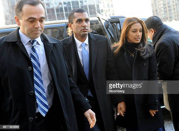 Mathew Martoma a former portfolio manager with SAC Capital Advisors LP center holds hands with his wife Rosemary Martoma right as they arrive at...