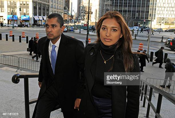 Mathew Martoma a former portfolio manager with SAC Capital Advisors LP left holds hands with his wife Rosemary Martoma as they arrive at federal...