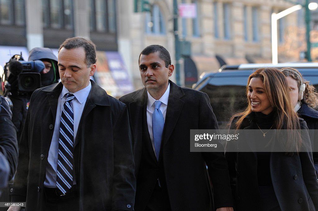 Mathew Martoma, a former portfolio manager with SAC Capital Advisors LP, center, holds hands with his wife Rosemary Martoma, right, as they arrive at federal court in New York, U.S., on Tuesday, Jan. 7, 2014. Mathew Martoma, whose trial begins today, won rulings limiting the evidence prosecutors can use to try to prove he made $276 million for SAC based on inside information from two doctors supervising a clinical drug trial. Photographer: Peter Foley/Bloomberg via Getty Images