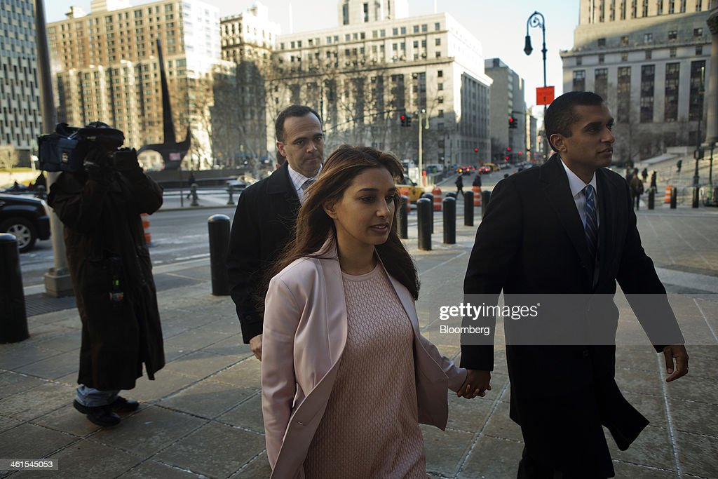 Mathew Martoma, a former portfolio manager with SAC Capital Advisors LP, right, holds hands with his wife Rosemary Martoma as they arrive at federal court in New York, U.S., on Thursday, Jan. 9, 2014. Mathew Martoma, on trial for insider trading, lost a bid to show jurors what founder Steven Cohen told regulators about the sale of Wyeth stock at the center of the case -- statements he argues exonerate him. Photographer: Victor J. Blue/Bloomberg via Getty Images