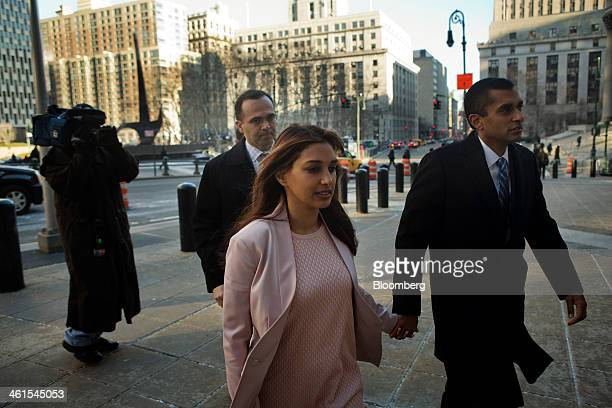 Mathew Martoma a former portfolio manager with SAC Capital Advisors LP right holds hands with his wife Rosemary Martoma as they arrive at federal...
