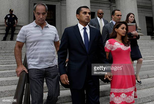 Mathew Martoma a former SAC Capital Advisors LP fund manager center and his wife Rosemary Martoma exit federal court following a sentencing hearing...