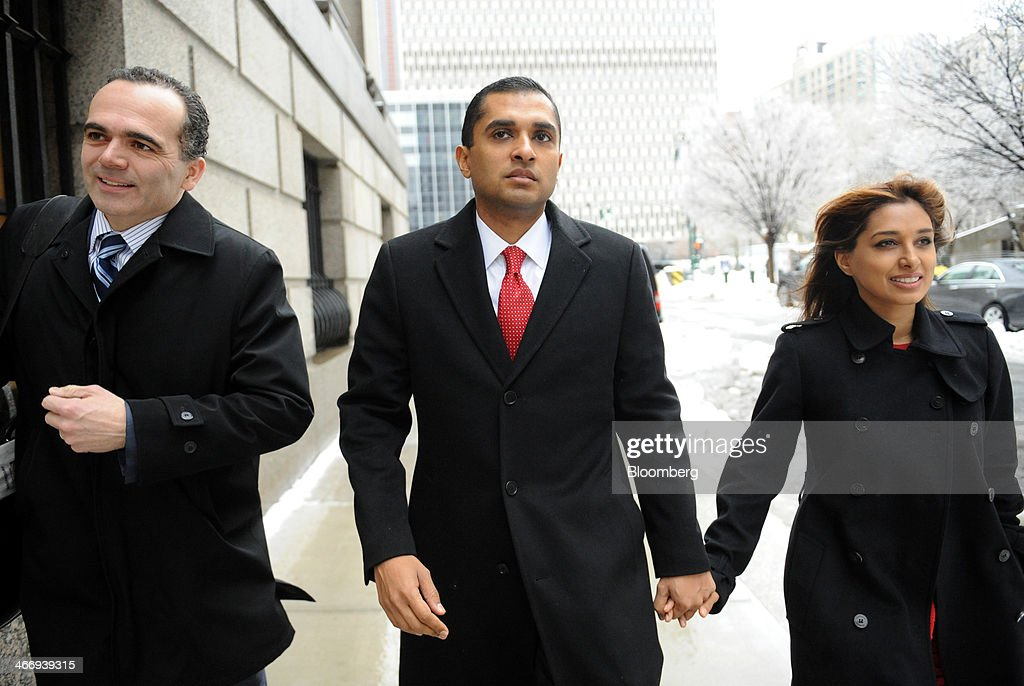 Mathew Martoma, a former SAC Capital Advisors LP fund manager, center, arrives at federal court with his wife Rosemary Martoma, right, and his attorney Roberto Braceras in New York, U.S., on Wednesday, Feb. 5, 2014. Jury deliberations continue for a second day in the trial of Mathew Martoma, accused by federal prosecutors of masterminding the most lucrative insider trading scheme in U.S. history. Photographer: Louis Lanzano/Bloomberg via Getty Images