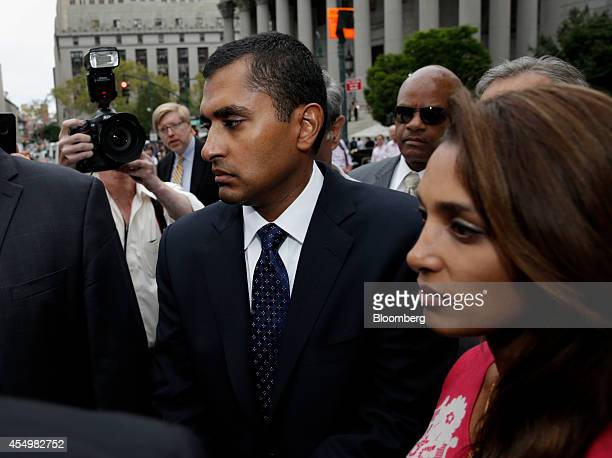 Mathew Martoma a former SAC Capital Advisors LP fund manager left and his wife Rosemary Martoma exit federal court following a sentencing hearing in...