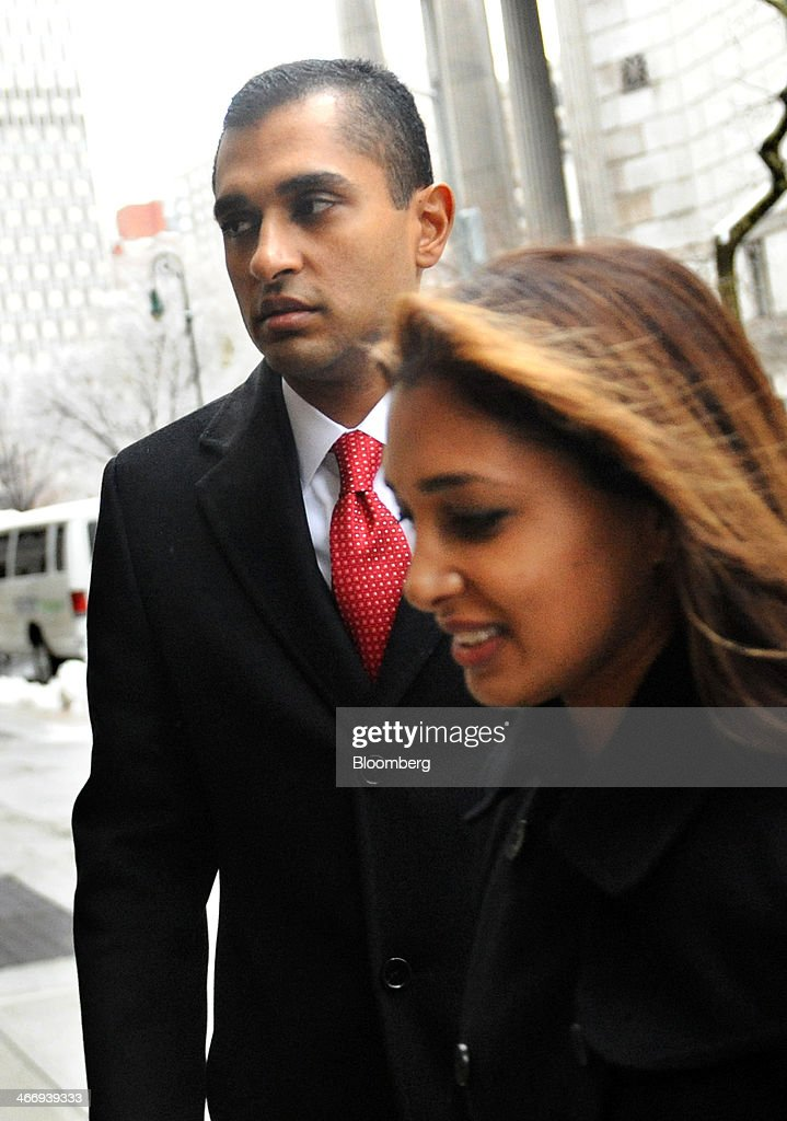 Mathew Martoma, a former SAC Capital Advisors LP fund manager, left, arrives at federal court with his wife Rosemary Martoma in New York, U.S., on Wednesday, Feb. 5, 2014. Jury deliberations continue for a second day in the trial of Mathew Martoma, accused by federal prosecutors of masterminding the most lucrative insider trading scheme in U.S. history. Photographer: Louis Lanzano/Bloomberg via Getty Images