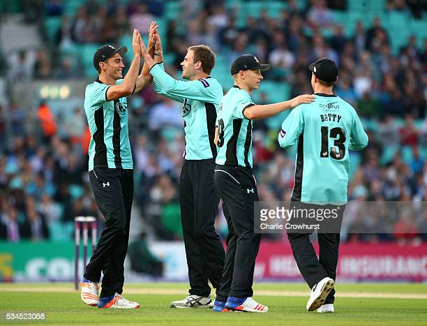 Mathew Pillans of Surrey celebrates taking the wicket of David Lloyd of Glamorgan during the Natwest T20 Blast match between Surrey and Glamorgan at...