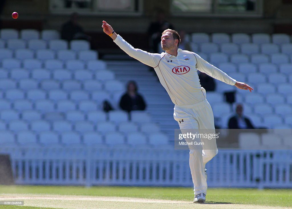 Mathew Pillans of Surrey fails to take a catch of his own bowling during the Specsavers County Championship Division One match between Surrey and Durham at the Kia Oval Cricket Ground, on May 04, 2016 in London, England.