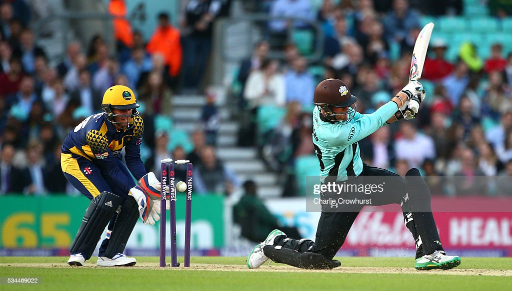 Mathew Pillans of Surrey is bowled out while Chris Cooke of Glamorgan (L) looks on during the Natwest T20 Blast match between Surrey and Glamorgan at The Kia Oval on May 26, 2016 in London, England.