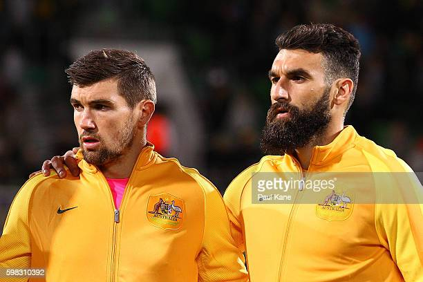 Mathew Ryan and Mile Jedinak of Australia look on as the Australian National Anthem is played during the 2018 FIFA World Cup Qualifier match between...