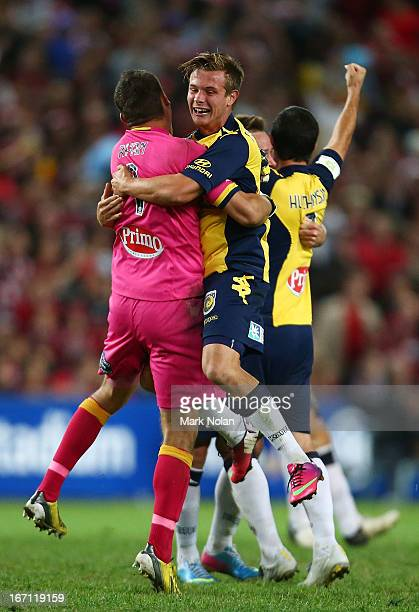 Mathew Ryan and Nick Fitzgerald of the Mariners celebrate victory after the ALeague 2013 Grand Final match between the Western Sydney Wanderers and...