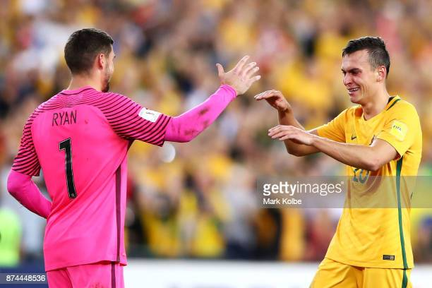 Mathew Ryan of Australia and Trent Sainsbury of Australia celebrate victory during the 2018 FIFA World Cup Qualifiers Leg 2 match between the...