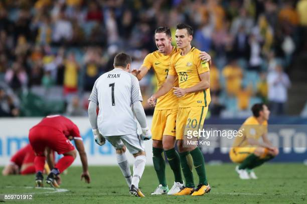 Mathew Ryan of Australia celebrates victory with Milon Degenek and Trent Sainsbury during the 2018 FIFA World Cup Asian Playoff match between the...