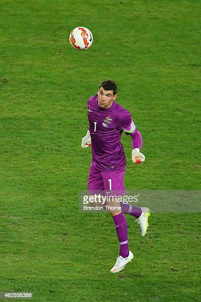 Mathew Ryan of Australia heads the ball during the 2015 Asian Cup final match between Korea Republic and the Australian Socceroos at ANZ Stadium on...