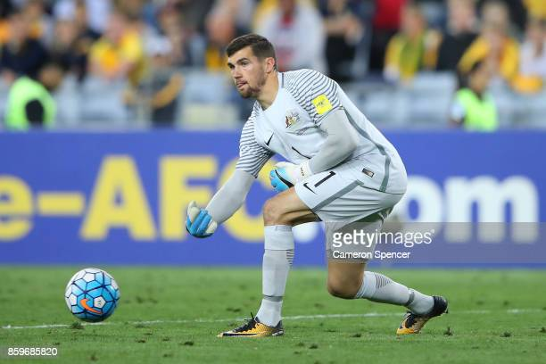 Mathew Ryan of Australia passes during the 2018 FIFA World Cup Asian Playoff match between the Australian Socceroos and Syria at ANZ Stadium on...