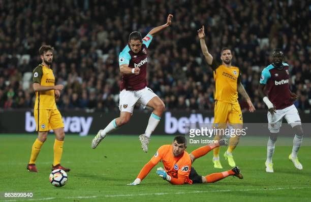 Mathew Ryan of Brighton and Hove Albion saves from Javier Hernandez of West Ham United during the Premier League match between West Ham United and...
