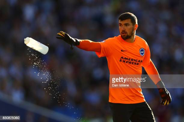 Mathew Ryan of Brighton and Hove Albion throws a water bottle during the Premier League match between Brighton and Hove Albion and Manchester City at...