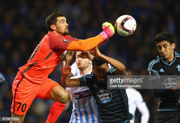 Mathew Ryan of Genk punches away from Gustavo Cabral of Celta Vigo during the UEFA Europa League quarter final second leg between KRC Genk and Celta...
