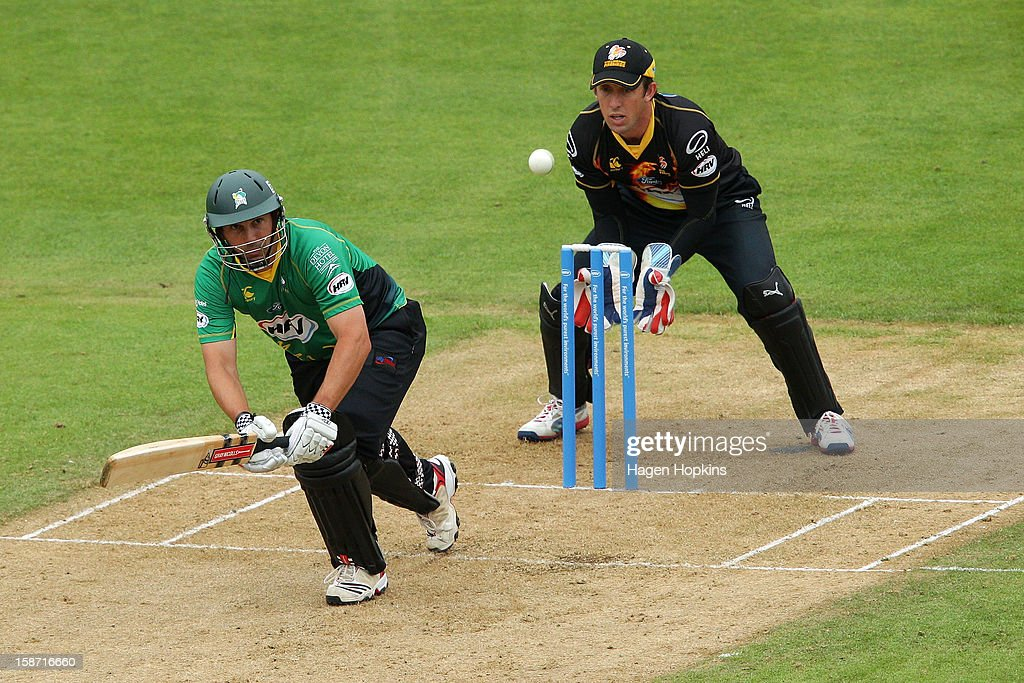 Mathew Sinclair of Central Districts bats while Luke Ronchi of Wellington looks on during the Twenty20 match between Wellington Firebirds and Central Stags at Hawkins Basin Reserve on December 26, 2012 in Wellington, New Zealand.
