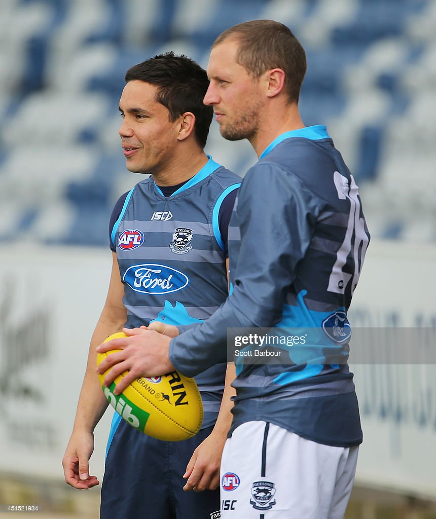 Mathew Stokes and James Kelly of the Cats look on during a Geelong Cats AFL training session at Simonds Stadium on September 3, 2014 in Geelong, Australia.