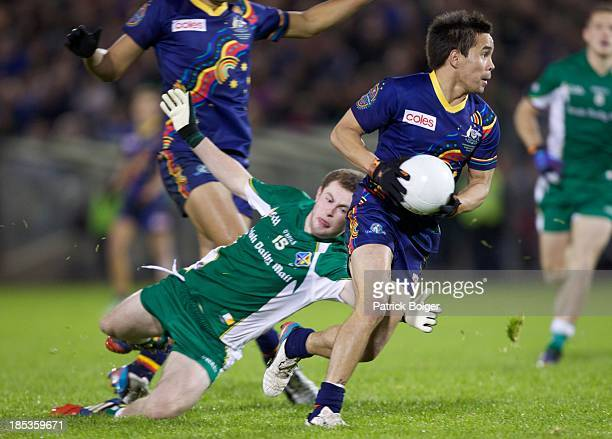 Mathew Stokes of Australia and Jack McCaffrey of Ireland in action during the International Rules 1st Test between Ireland and Australia at Breffni...