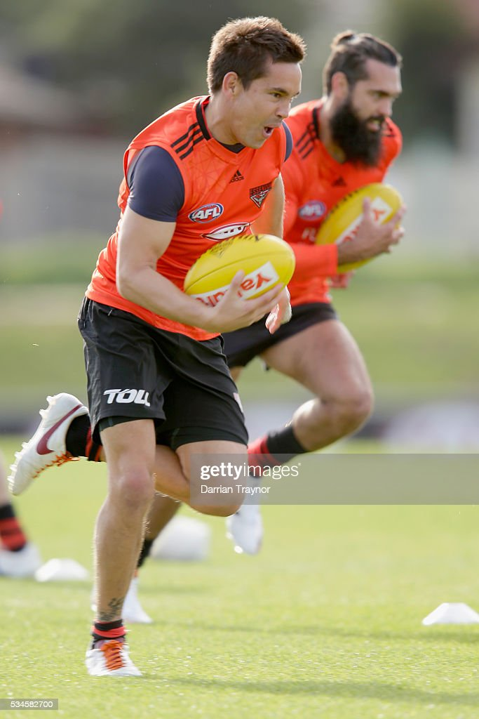 Mathew Stokes runs with the ball during an Essendon Bombers training session at True Value Solar Centre on May 27, 2016 in Melbourne, Australia.