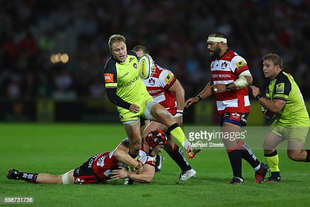 Mathew Tait of Leicester escapes the challenge from Tom Savage of Gloucester during the Aviva Premiership match between Gloucester and Leicester...