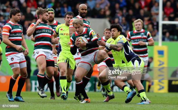 Mathew Tait of Leicester moves away from Denny Solomona during the Aviva Premiership match between Leicester Tigers and Sale Sharks at Welford Road...